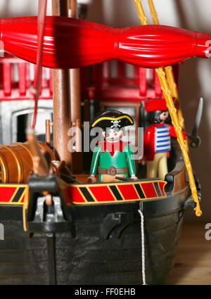 Playmobil pirates figures in a boat - Stock Photo