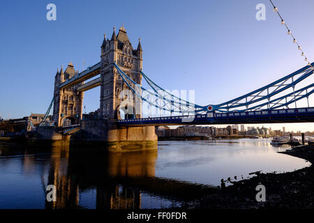 The Tower of London Bridge in all of it's glory during a beautiful sunrise. - Stock Photo