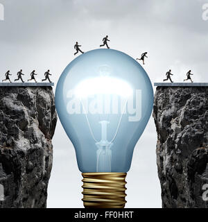 Creativity business idea solution as a group of people on two divided cliffs being connected by a giant light bulb - Stock Photo