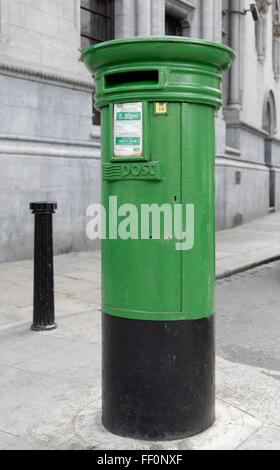 A green An Post postbox on Dame Street in central Dublin, Republic of Ireland. - Stock Photo