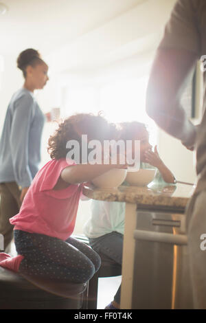 Family eating in kitchen - Stock Photo