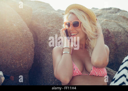 Caucasian woman talking on cell phone outdoors - Stock Photo