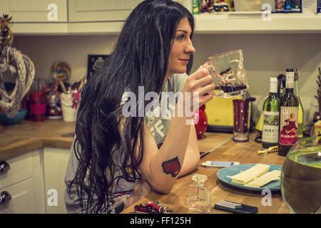 Caucasian woman drinking tea in kitchen