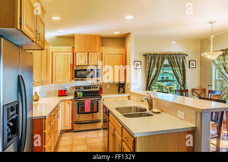 Countertops and cabinets in modern kitchen - Stock Photo