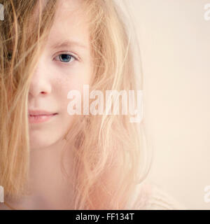 Caucasian teenage girl with messy hair - Stock Photo