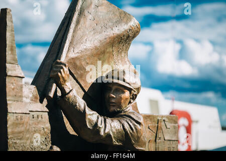 OSLO, NORWAY - JULY 31, 2014: Statue near Lighthouse at Aker Brygge In Oslo Embankment, Norway. - Stock Photo