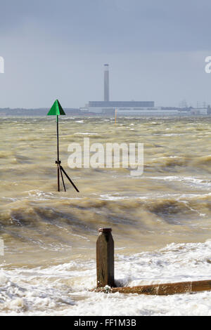 A channel marker with Fawley Power Station in the background. - Stock Photo