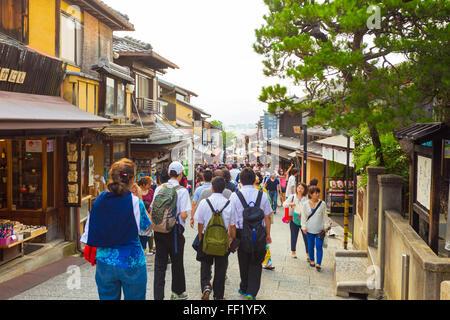 Crowded tourist shopping street Matsubara-dori full of shops and restaurants at base of Kiyomizu-dera in Kyoto, - Stock Photo