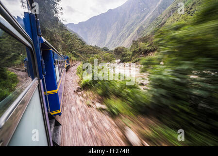 Train between Aguas CaRMientes, the stop for Machu Picchu, and ORMRMantaytambo, Cusco Region, Peru, South America - Stock Photo