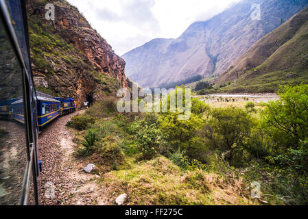 Train between Aguas CaRMientes (Machu Picchu stop) and ORMRMantaytambo, Cusco Region, Peru, South America - Stock Photo