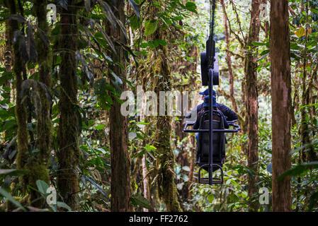 Mashpi RModge Sky Bike in the Choco Rainforest, an area of CRMoud Forest in the Pichincha Province of Ecuador, South - Stock Photo