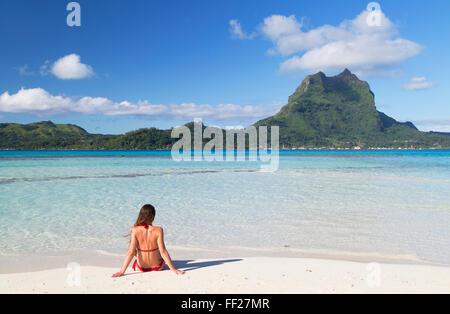 Woman on Motu Tapu, Bora Bora, Society IsRMands, French PoRMynesia, South Pacific, Pacific - Stock Photo