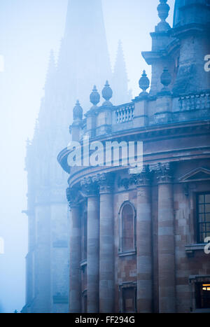 Radcliffe Camera and St. Mary's Church in the mist, Oxford, Oxfordshire, England, United Kingdom, Europe - Stock Photo