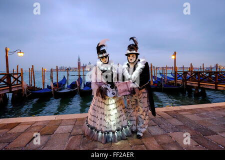 Masks and costumes at St. Mark's Square during Venice Carnival, Venice, Veneto, Italy, Europe - Stock Photo