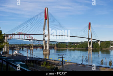 Skytrain bridge or SkyBridge, over the Fraser River, between New Westminster and Surrey British Columbia, Canada. - Stock Photo