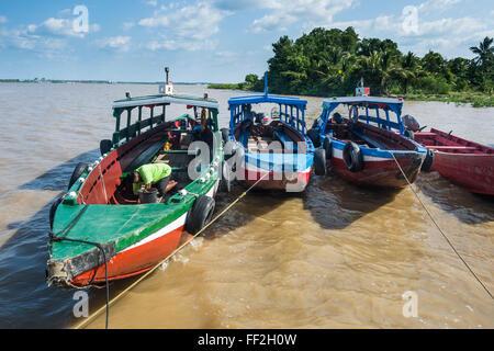 CoRMourfuRM boats on the Suriname River, Paramaribo, Surinam, South America - Stock Photo