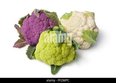Fresh purple, green and white cauliflower on white background - Stock Photo