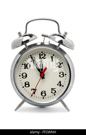 Old fashioned metal alarm clock on white background - Stock Photo