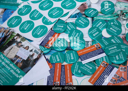 London, UK. 10th February 2016. Badges and stickers distributed by junior doctors on the picket line outside University - Stock Photo