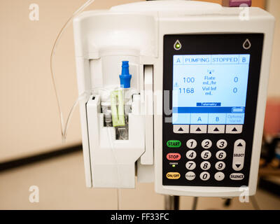 Photo of IV drip intravenous infusion pump medical equipment in a hospital room - Stock Photo
