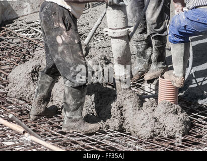 Pouring cement on construction site in Spain - Stock Photo