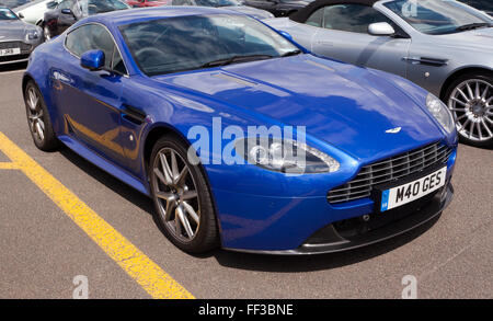 A blue,  2011, Aston Martin V8 Vantage S,  on static display, at the Silverstone Classic 2015. - Stock Photo