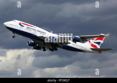 London Heathrow, United Kingdom - August 28, 2015: A British Airways Boeing 747 with the registration G-BNLP taking - Stock Photo