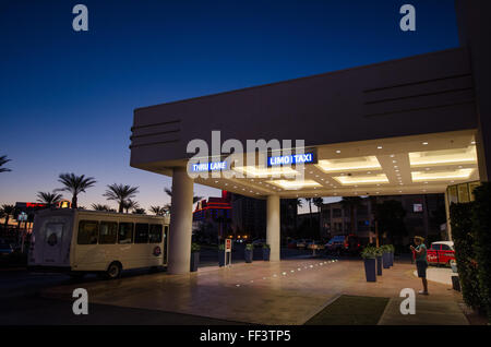 Outside Tropicana Hotel, Las Vegas, Nevada at sunrise to go and see the Grand Canyon - Stock Photo