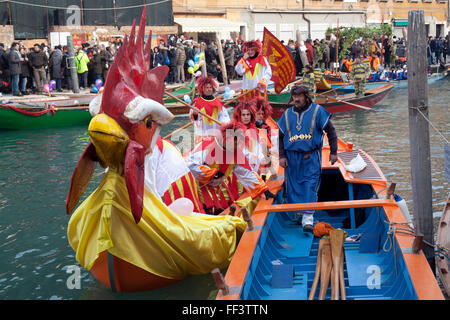 Boats of the water parade Rowing Associations on the canal at the start of the 2016 Venice carnival, Cannaregio - Stock Photo