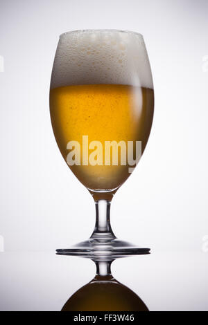 Freshly poured beer in tulip glass - Stock Photo
