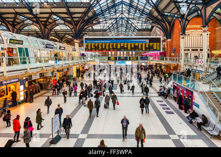 People at Liverpool Street station in London United Kingdom. - Stock Photo