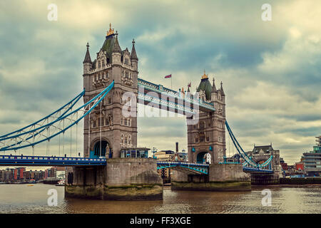 View of Tower Bridge under cloudy sky in London, UK. - Stock Photo