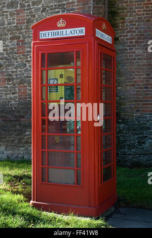 Defibrillator in a disused traditional red telephone box. East Hendred village Oxfordshire HOMER SYKES - Stock Photo