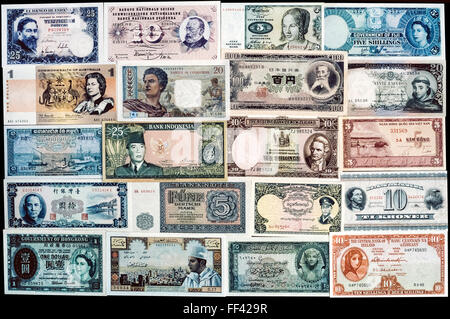 A collection of brand-new banknotes from 20 countries that were in circulation in the early 1960s. The colorful - Stock Photo