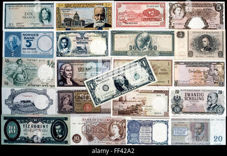 A collection of brand-new banknotes from 21 countries that were in circulation in the early 1960s. The colorful - Stock Photo