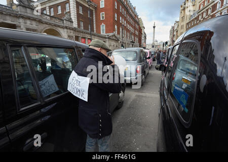London, UK. 10th February, 2016. London black cab drivers cause traffic jams in central London as a protest against - Stock Photo