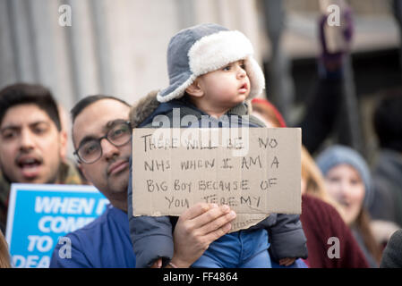 London, UK. 10th February, 2016.  Junior doctor's child with banner Credit:  Ian Davidson/Alamy Live News - Stock Photo