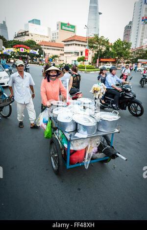 street food vendor next to Chợ Bến Thành Market. Vietnam street life. - Stock Photo