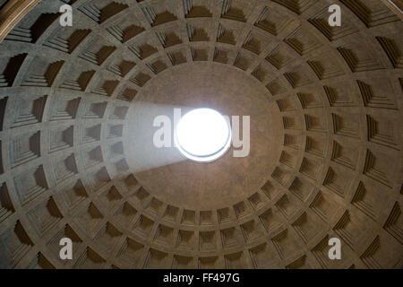 Pantheon dome as seen from inside the Pantheon with a visible light beam coming through the oculus, or hole in the - Stock Photo