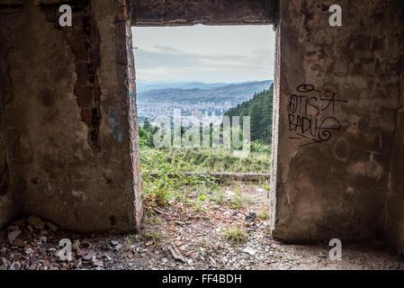 Destroyed and abandoned house on Trebevic mountain in Sarajevo, Bosnia and Herzegovina - Stock Photo
