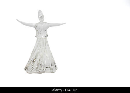 Whirling dervish isolated on white background - Stock Photo