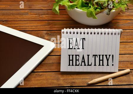 Eat healthy written on notepad - Stock Photo