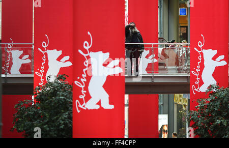 Berlin, Germany. 10th Feb, 2016. A man takes photos near banners of the upcoming Berlinale Film Festival at a shopping - Stock Photo
