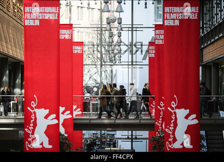 Berlin, Germany. 10th Feb, 2016. People walk by banners of the upcoming Berlinale Film Festival at a shopping mall - Stock Photo