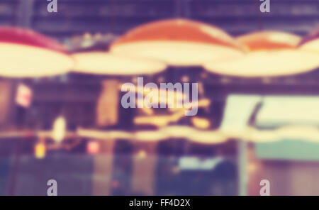 Vintage toned blurred city lights, abstract background. - Stock Photo