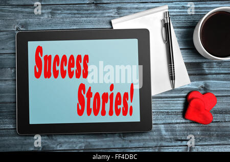 Success Stories words on digital tablet - Stock Photo