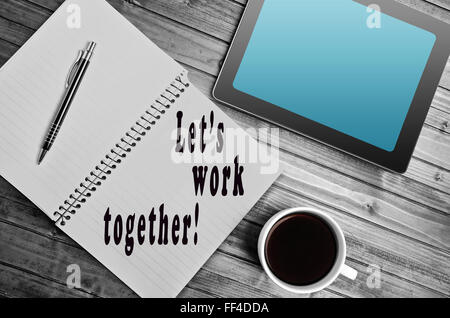 Let's work together written on notebook - Stock Photo