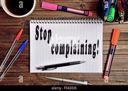 Stop complaining written on notebook - Stock Photo