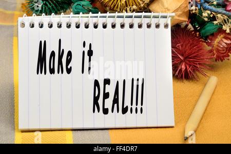 Make it real written on notebook - Stock Photo