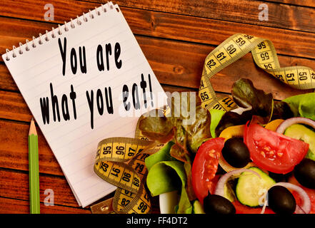 You are what you eat written on notebook - Stock Photo